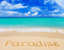 Word Paradise on beach Stock Photos