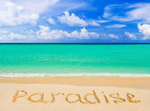 Word Paradise on beach Royalty Free Stock Photos