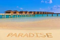 Word Paradise on beach stock photo