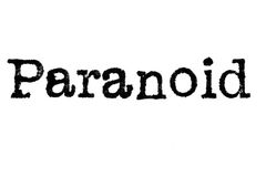 The word `Paranoid` from a typewriter on white Stock Photos