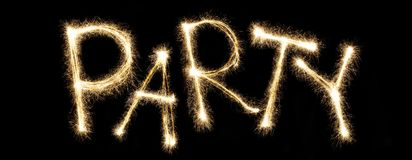 Word party written with sparkler letters Stock Image