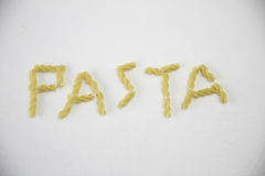 The word pasta. Pasta spelled out with pasta Royalty Free Stock Photo