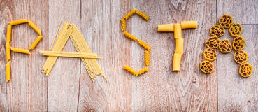 Word pasta written with different shapes of pasta Stock Image
