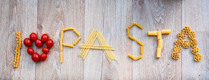 Word pasta written with different shapes of pasta Royalty Free Stock Image