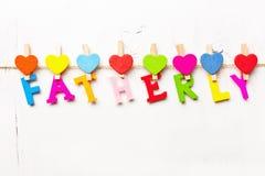 Word paternel des lettres colorées Photos stock