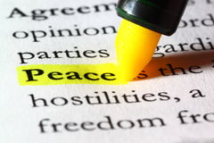Word peace highlighted with a yellow marker. The word peace written on paper and  highlighted with a yellow marker Stock Photography
