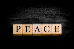 Word PEACE isolated on black background with copy space Stock Photo