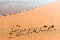 Word Peace on sand Royalty Free Stock Photo