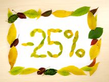 Word 25 percent made of autumn leaves inside of frame of autumn leaves on wood background. Twenty five percent sale. Sale template. Word 25 percent made of stock image