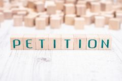 The Word Petition Formed By Wooden Blocks On A White Table. The Word Petition Formed By Wooden Blocks On White Table stock photos