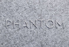 Word of the phantom on a gray foam. The pressed letter Royalty Free Stock Images