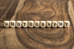 Word PHOTOGRAPHY on wooden cubes Stock Photos
