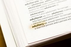 The word or phrase Adultery in a dictionary. Highlighted with marker stock photos