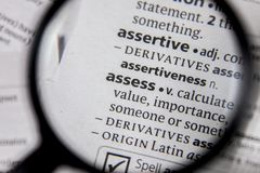 The word or phrase assess in a dictionary. Book stock photography