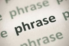 Word phrase printed on paper macro. Word phrase printed on white paper macro Royalty Free Stock Photography