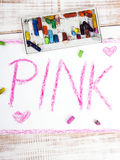 Word PINK written in pink crayon Stock Images