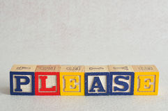The word please spelled with colorful alphabet blocks Stock Photos