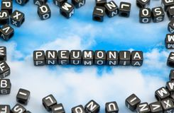 The word pneumonia. On the sky background Stock Photos