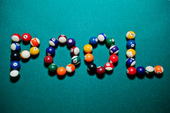 The word pool from billiard balls Stock Photo
