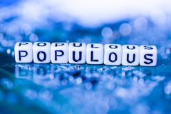 Word POPULOUS formed by alphabet blocks on mother cryptocurrency. Closeup Stock Images