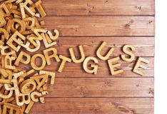 Word portuguese made with wooden letters stock photos