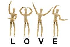 Word posé par mannequin en bois Photo stock