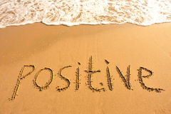 Word positive draw on beach Royalty Free Stock Images