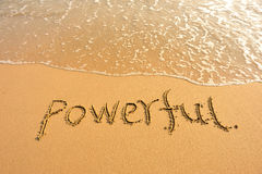 Word powerful draw on beach. Word powerful draw on golden beach Stock Images