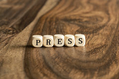 Word PRESS on wooden cubes Royalty Free Stock Photo