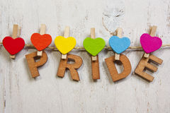Word pride attached rainbow hearts Royalty Free Stock Images