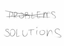 The word problem is crossed out and the word solution is written in black Stock Photos