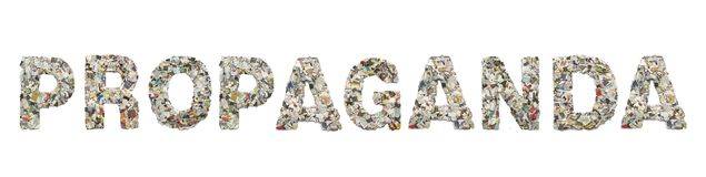 The word PROPAGANDA made from newspaper. Confetti isolated on old paper royalty free stock photos