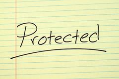 Protected On A Yellow Legal Pad Royalty Free Stock Photo
