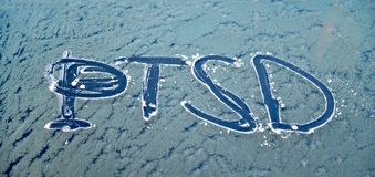 The word PTSD written frosty car glass Stock Images
