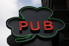 Irish Pub. The word Pub inside a Shamrock, in neon royalty free stock photography