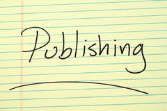 Publishing On A Yellow Legal Pad. The word `Publishing` underlined on a yellow legal pad Royalty Free Stock Photography