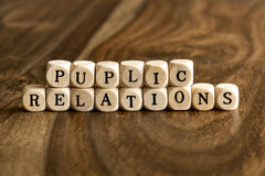 Word PUPLIC RELATIONS on wooden cubes Royalty Free Stock Photo