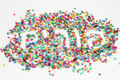 The Word Purim in Hebrew made from confetti. Colorful confetti forming the word Purim in Hebrew. The confetti symbolizes the fun and celebration of Purim holiday Royalty Free Stock Photography