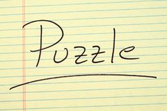 Puzzle On A Yellow Legal Pad Royalty Free Stock Photo