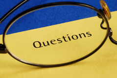 The word Questions. Concepts of inquiry and investigation Stock Image