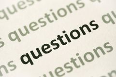 Word questions printed on paper macro. Word questions printed on white paper macro Royalty Free Stock Image