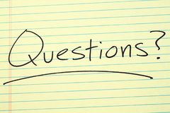 Questions? On A Yellow Legal Pad Royalty Free Stock Images