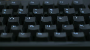 Word Quiet on Computer. Keyboard royalty free stock image