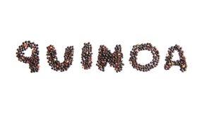Word QUINOA met zwarte zaden wordt geschreven dat stock foto's