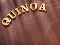 The word quinoa in wooden letters - Chenopodium quinoa. Text space royalty free stock photography