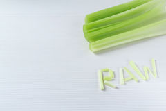 The Word Raw from celery stalks background stock images