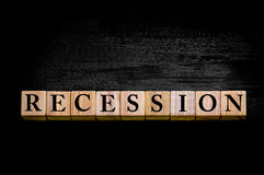 Word RECESSION isolated on black background Royalty Free Stock Photo