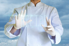 The word recipe in the hands. Stock Photo