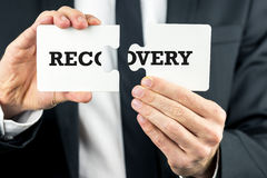 The word Recovery on puzzle pieces Stock Photography