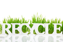 Word Recycle with fresh grass Royalty Free Stock Image